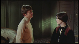 Roddy McDowell (as Fischer) and Pamela Franklin (as Tanner) in The Legend of Hell House