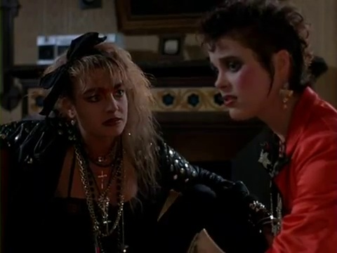Bunty Bailey and Cassie Stuart in a Scene from Dolls (1987)